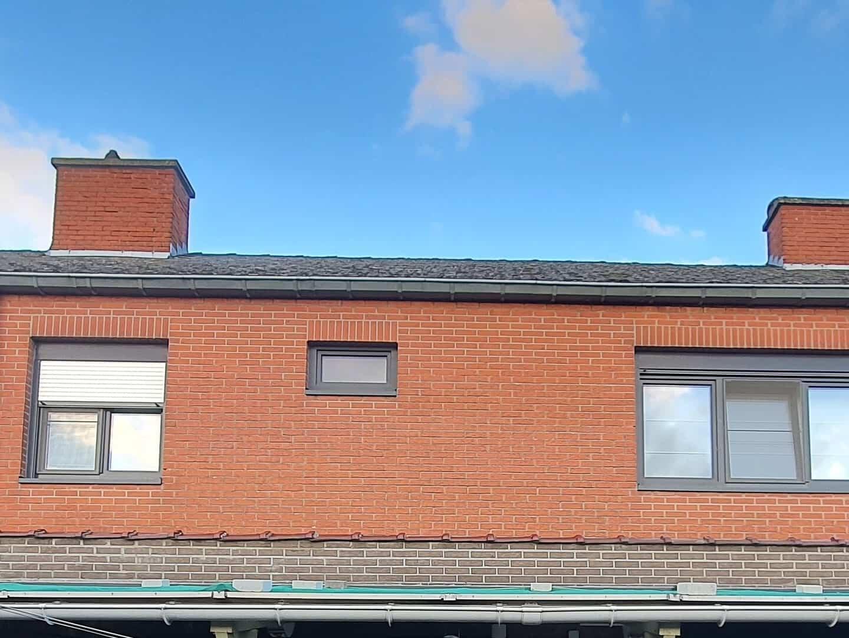 Achterkant te renoveren leien dak in Bornem